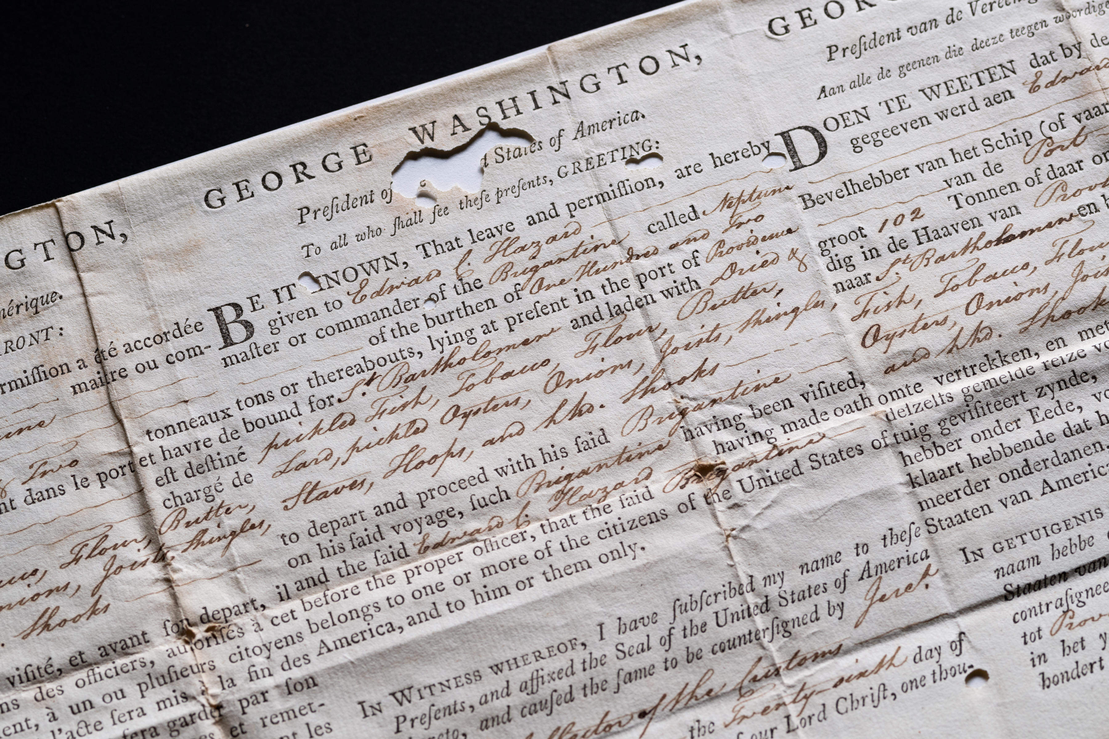 Detail from a weathered printed document, that includes manuscript inscriptions, shows text in English from the president of the united states.