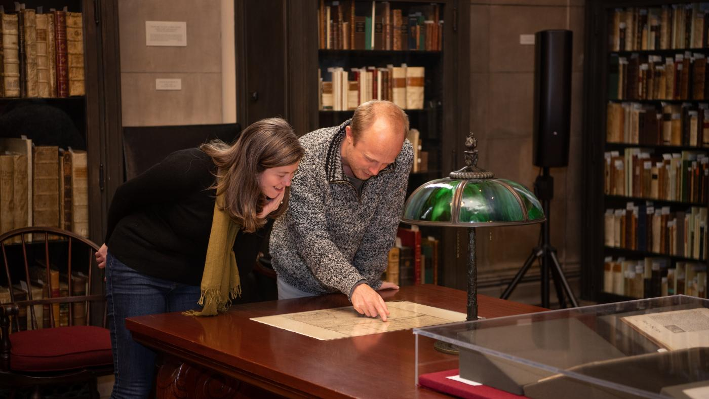 JCB Fellows Hannah Knox Tucker and Arthur Weststeijn consult a map in the reading room