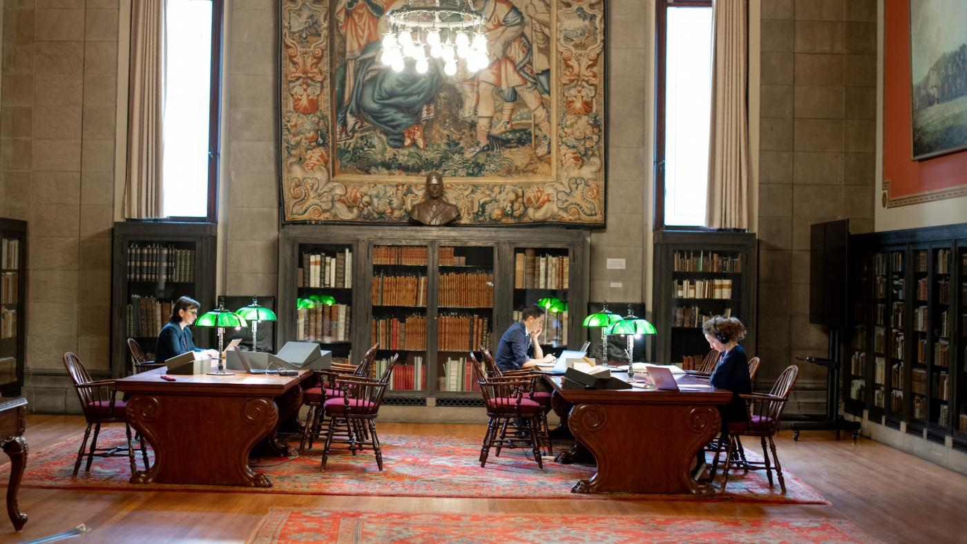 researchers work in the library's reading room