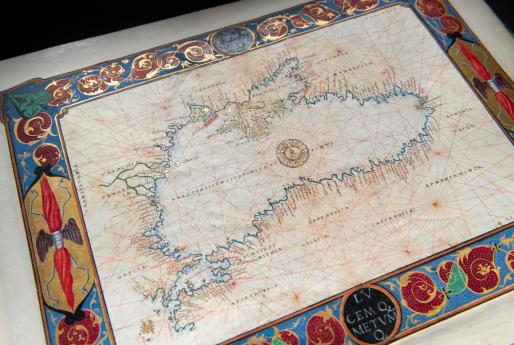 Detail of a colored manuscript map shows the Black Sea with labels. Decorative border includes red, blue, and green ink and gilded details.