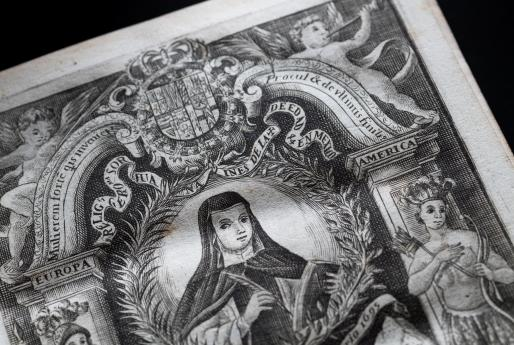 Detail of a printed book shows a decorated title page depicting an illustration of Sor Juana, angels, indigenous people, and text in Spanish and Latin.