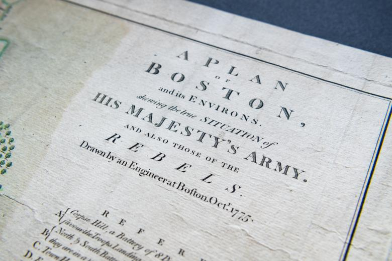 """Detail of a hand colored, engraved map of Boston, Massachusetts shows title """"A map of Boston, and its Environs. shewing the true situation of His Majesty's Army. and also those of the rebels."""""""