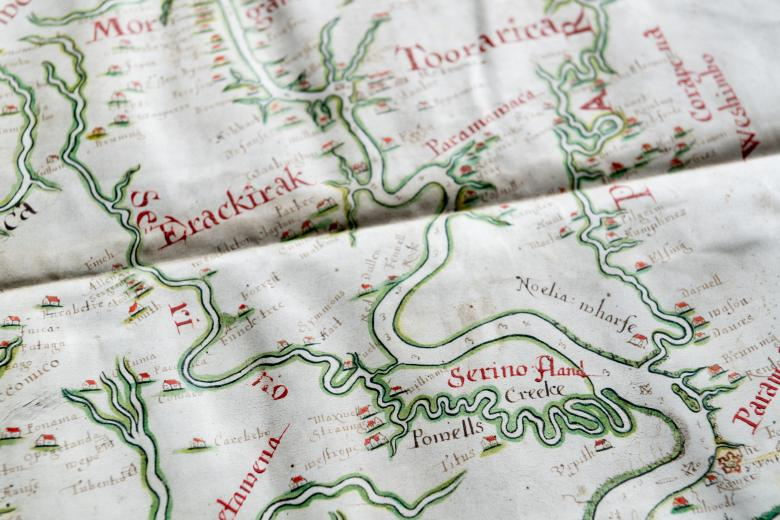 Detail of hand colored, manuscript map shows rivers (outlined in green) and labels written in red ink. Plantations are labeled with surnames.