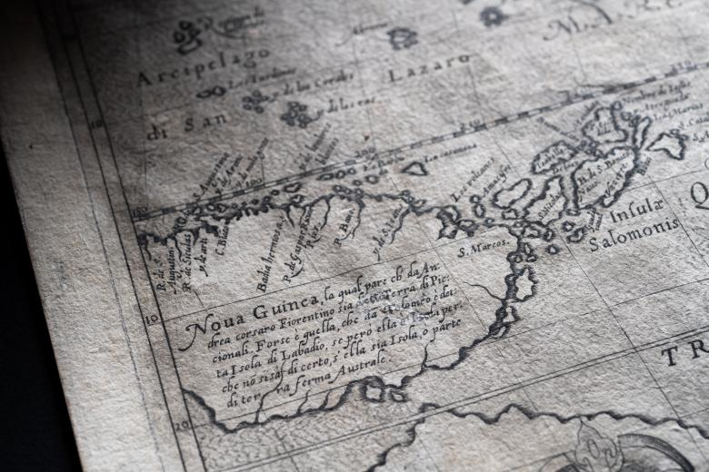 """Detail of a map shows text in Latin, some of which reads """"noua guinea"""" over New Guinea."""
