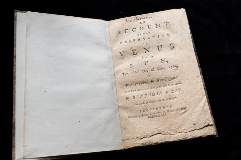 """Detail of a printed book shows title page with text in English reading """"An account of the observations of Venus"""" and manuscript notations at the top of the page."""