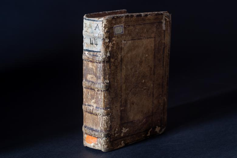 Printed book bound in leather shows some wear on the front cover and spine.
