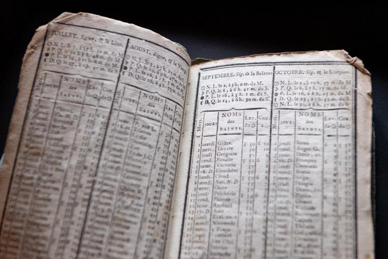 printed tables of days, lunar events, and sunrise and sunset during the months of July, August, September and October