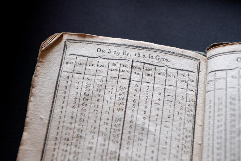 printed tables of exchange rates between two forms of currency (gourdes and livres)