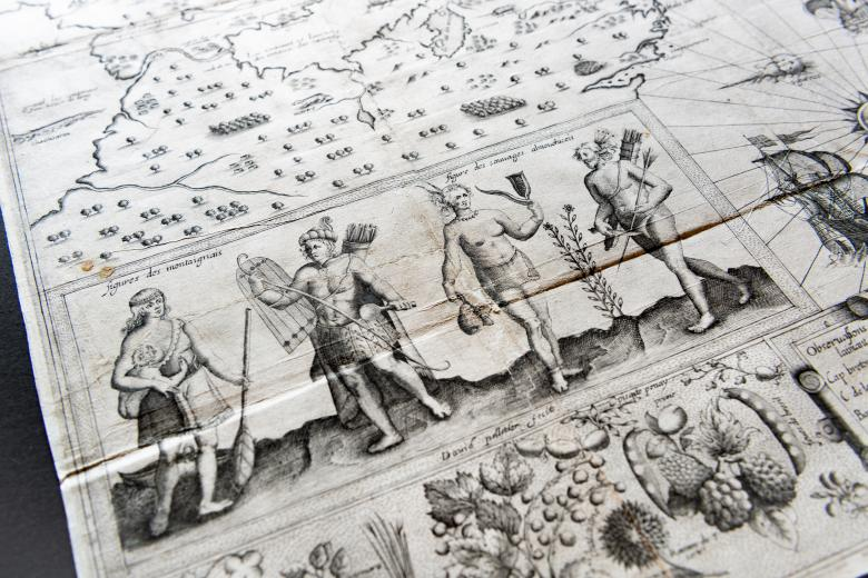 Detail of a printed map shows a group of people holding, among other things, arrows and a shield.