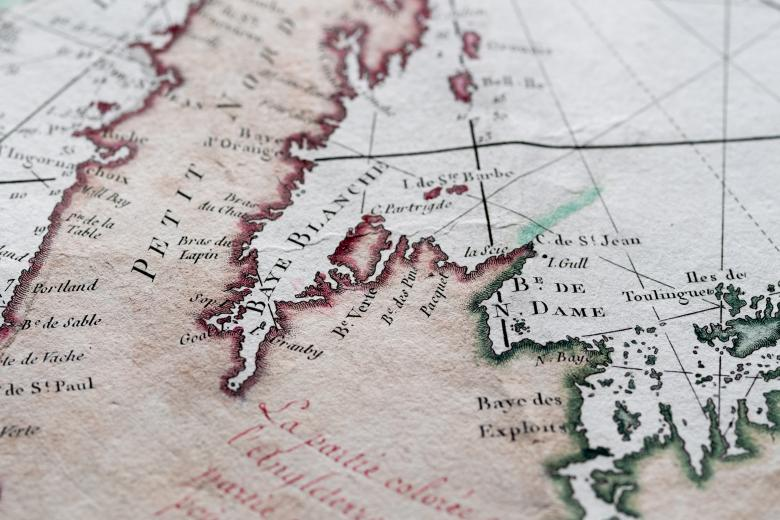 Detail of a hand colored printed map shows text in French to label geographic locations of importance.