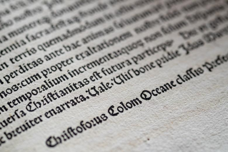 """Detail of a printed page shows text in Latin. Christopher Columbus' name appears in Latin as """"Christoforus Colom."""""""