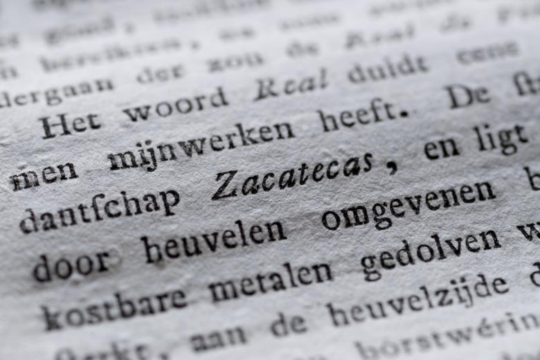 """Detail of a printed book shows text in Dutch, with the Mexican state """"Zacatecas"""" written in italics."""