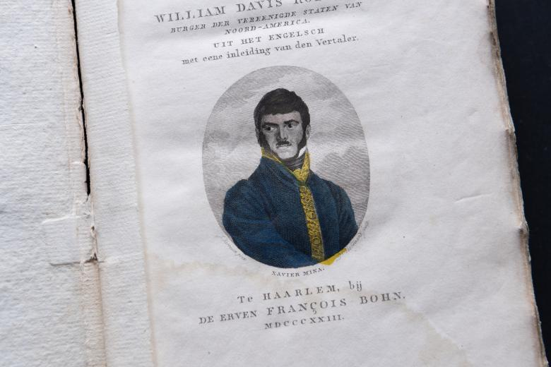 Detail of a printed book shows a hand colored portrait of a man on the title page with text in Dutch.