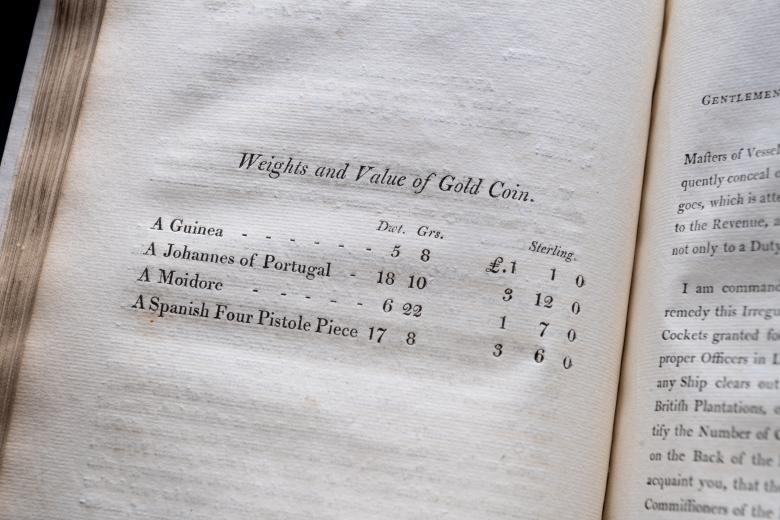 printed list of weights and values of gold coins