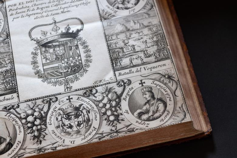 Detail of an engraved title page shows medallion portraits at the border, a coat of arms, and text in Spanish. Illustrations of the landscape are also drawn in the borders. Illustrations of fruit and plants are also included in the borders.