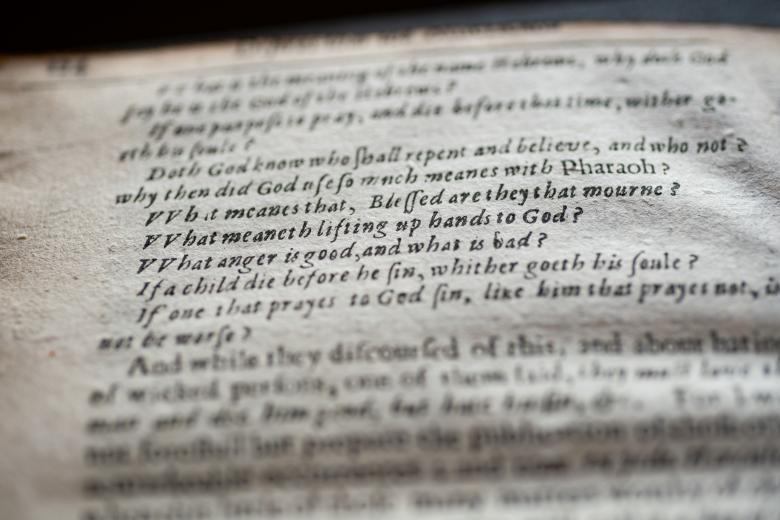 Detail of a printed book shows text in English listing a series of questions.