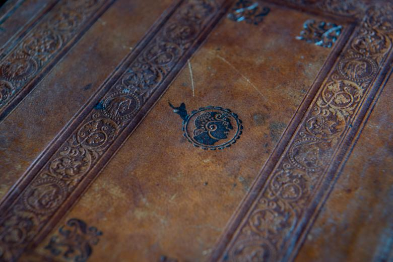 Detail of brown book binding shows the embossed details.