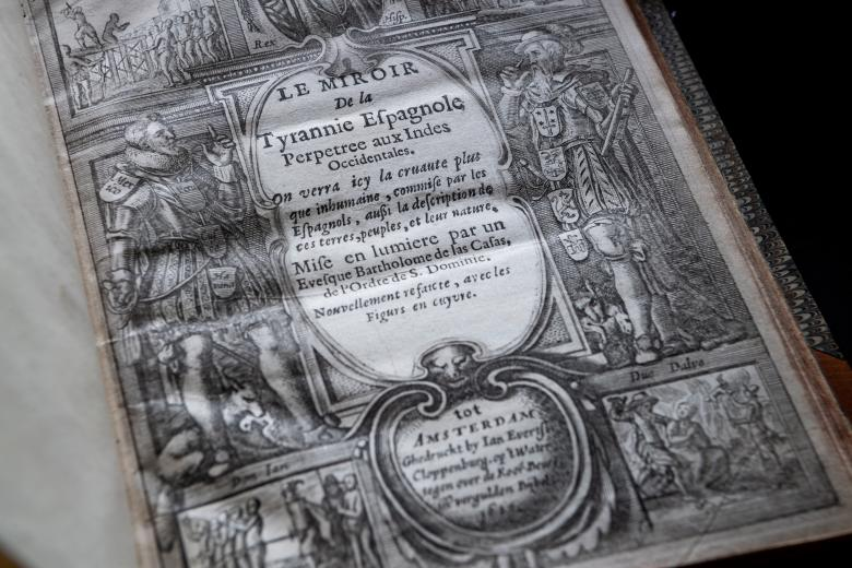 Detail of printed frontispiece shows two men on either side of French title.