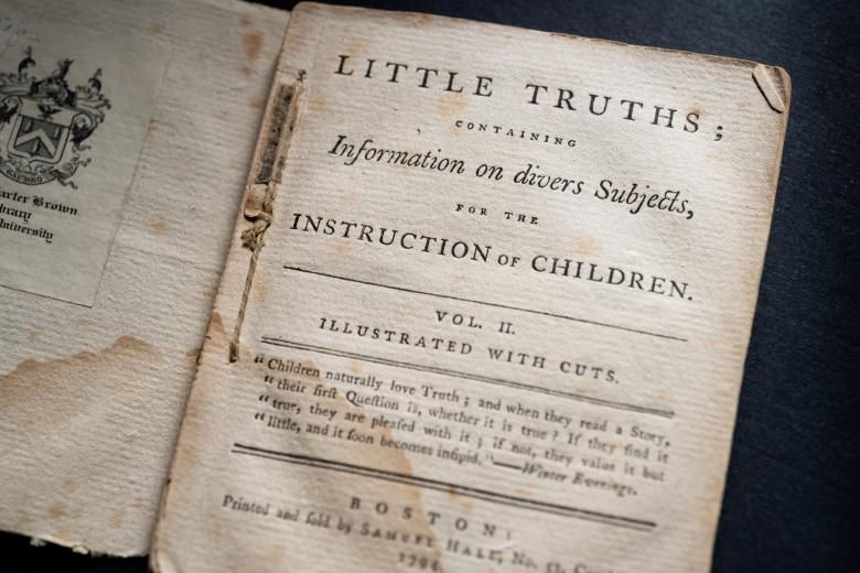 """Detail of a printed book shows text in English on the title page reading """"Little Truths; Containing information on divers subjects for the instruction of children."""""""