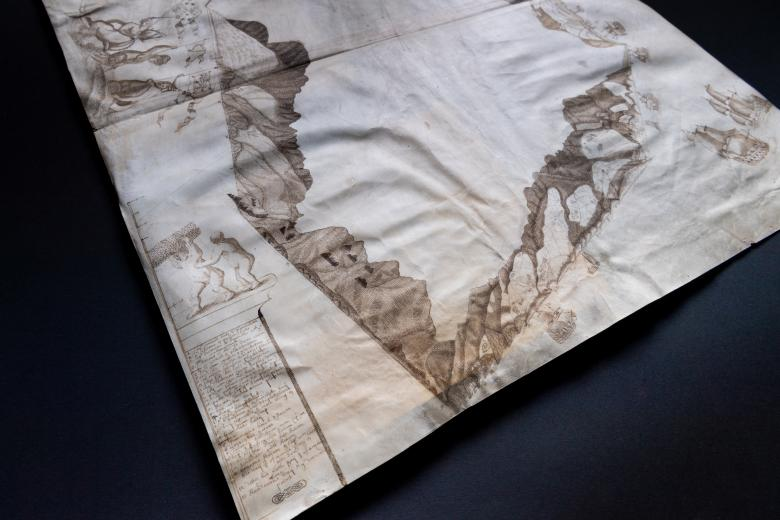 Detail of a manuscript map shows coastal profiles which includes mountainsides and decorative elements such as people holding reeds.