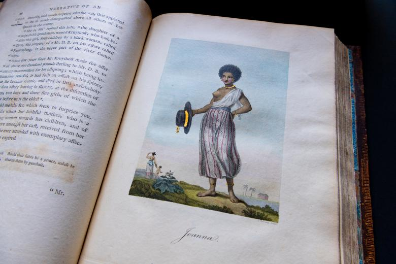 """Engraved, hand colored illustration shows a portrait of a young, enslaved Black woman. Text below reads """"Joanna."""""""