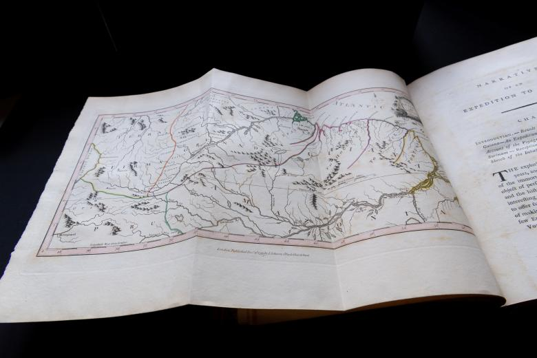 Engraved, hand colored fold-out map shows green, orange and pink details.