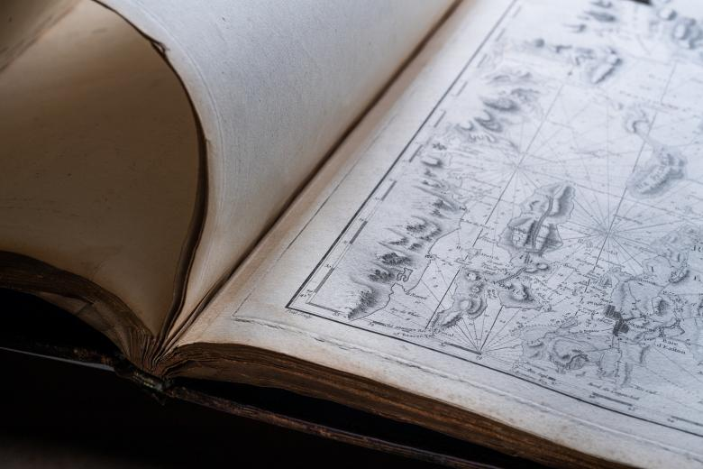 Detail of a printed atlas shows a full-page map.