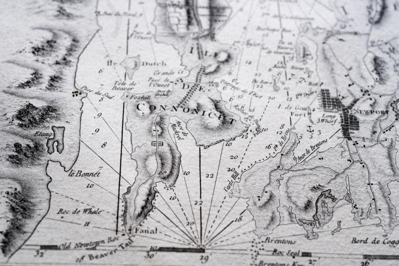 Detail of a printed atlas shows a portion of a map with labels in French and numbers indicating depth of water.