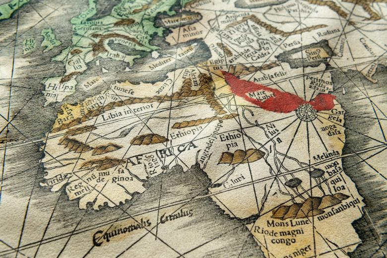 Detail of a hand colored, woodcut map shows Africa. Some details shown include labels in Latin and mountains.