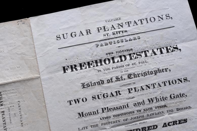 """Detail of printed document shows text reading """"Valuable Sugar Plantations, St. Kitts. Particulars of two valuable freehold estates, in the Parrish of St. Paul, in the Island of St. Christopher, Consisting of two plantation."""""""