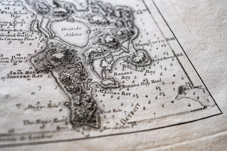 """Detail of a printed map shows Detroit with labels reading """"Grande Saline,"""" """"Mosquitto Bay,"""" and so on."""