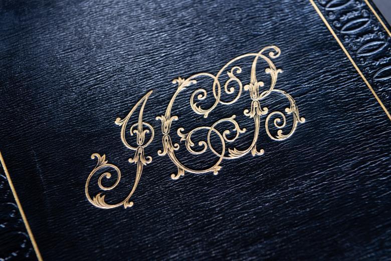 Detail of gold JCB stamp on black binding.