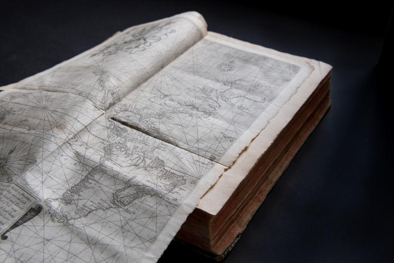 Fold-out engraved map depicts the Americas.