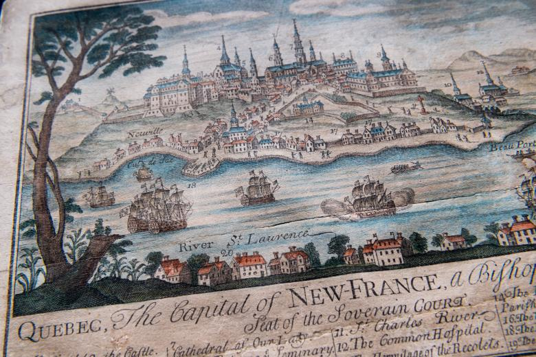 """Detail of engraved, hand colored print of Quebec City shows fortifications, churches and cathedral, statehouse, ships, and dwellings. Also includes title reading """"Quebec, the Capital of New France"""" and other text in English."""