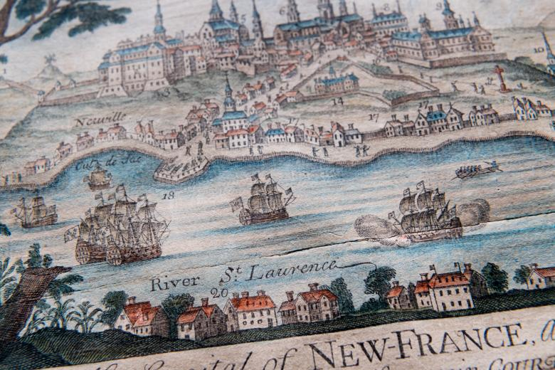 """Detail of engraved, hand colored print of Quebec City shows fortifications, churches and cathedral, statehouse, ships, and dwellings. Also includes label reading """"River St. Lawrence"""" and numbered items."""