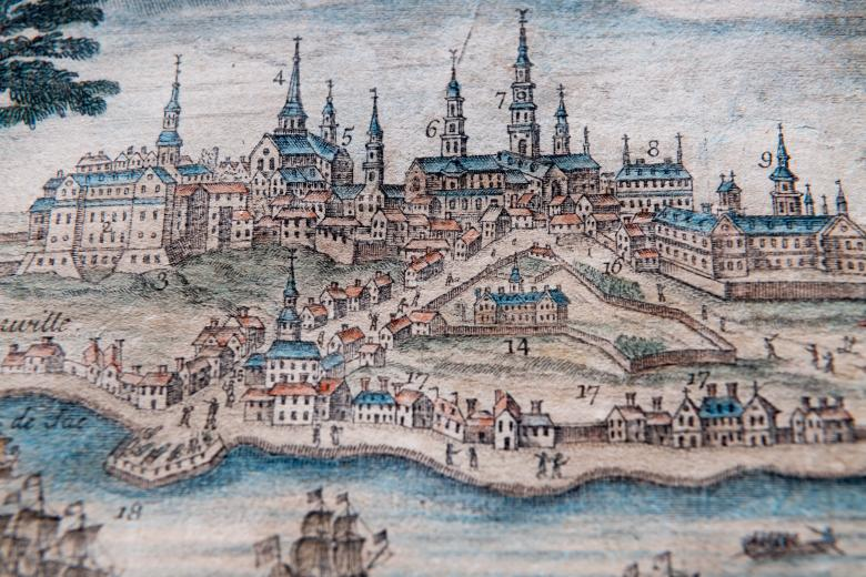 Detail of engraved, hand colored print of Quebec City shows fortifications, churches and cathedral, statehouse, ships, and dwellings, many of which are labeled with numbers.