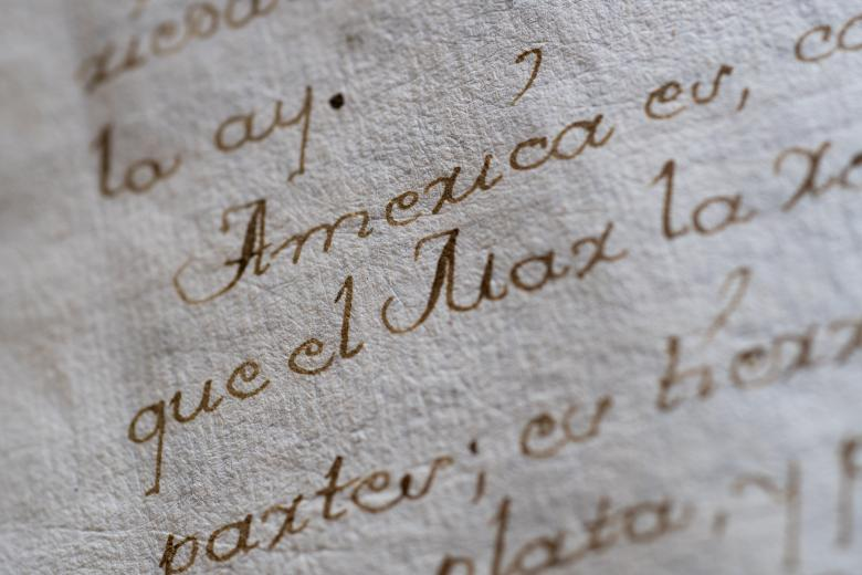 """Detail from a manuscript codex shows """"America"""" in focus within a Spanish text."""