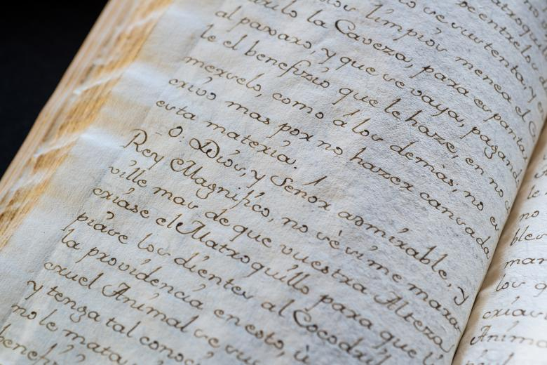 """Detail from a manuscript codex shows text in Spanish with mention of """"Dios."""""""