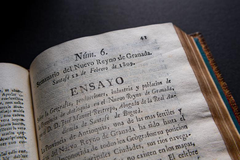 """Detail from a printed book shows text in Spanish including """"Ensayo"""" at the top of the page."""
