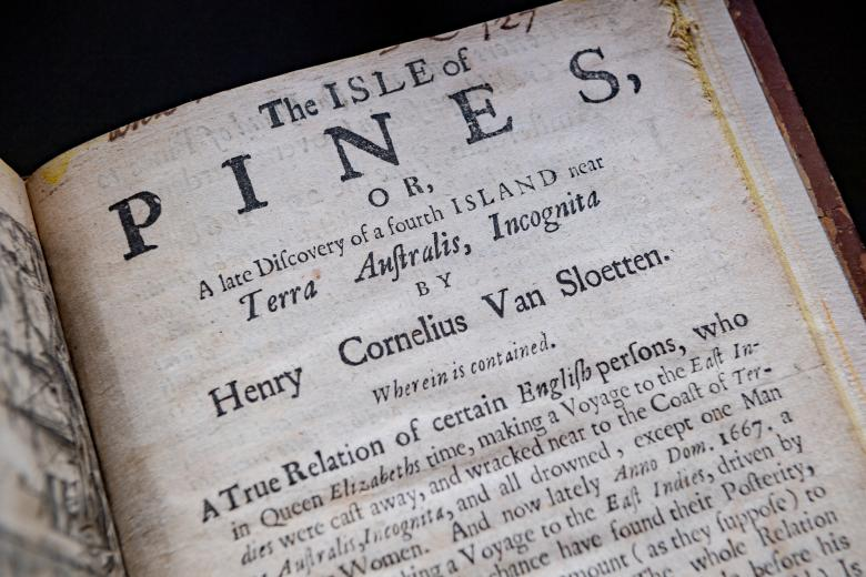 """Detail of a printed title page shows text in English reading """"The Isle of Pines, or, A late Discovery of a fourth Island near Terra Australis Incognita by Henry Cornelius Van Sloetter."""""""