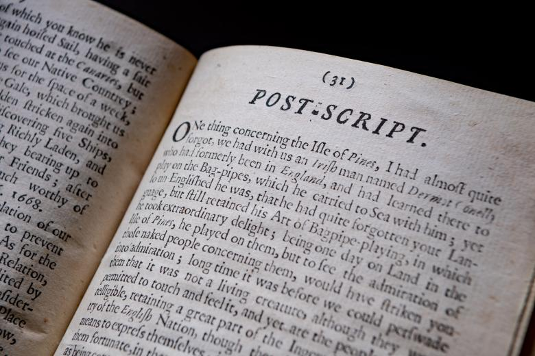 """Detail of a printed book shows text in English reads """"Post Script"""" at the top of the page."""