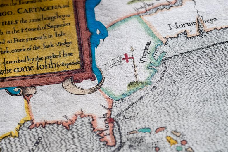 """Detail of a colored, engraved map shows """"Florida,"""" """"Virginia,"""" and partial view of frontispiece with text in English."""
