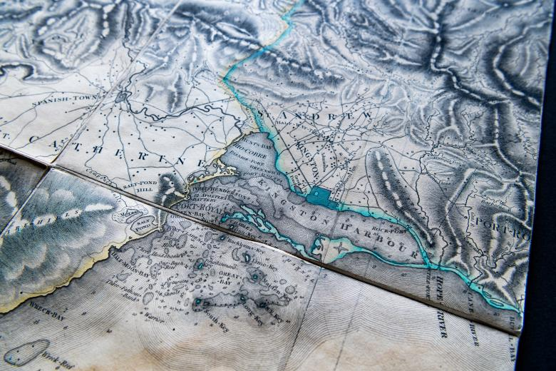 Detail of an engraved, colored map of Jamaica shows Kingston Harbor outlined in a greenish blue color, St. Catherine, and St. Andrew. Other surrounding locations labeled in English.