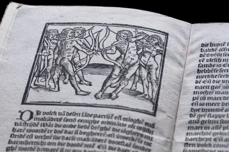 Detail of a printed text shows an illustration of a group of naked Natives holding crossbows and surrounded by trees. Text in Dutch is also visible.