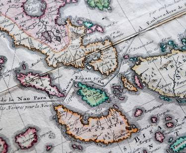 "Detail of a pink, orange, and blue colored, engraved map shows islands of Philippines such as ""Masbate"" and ""Ticao."" Other details include a line partially labelled ""de la Nao para la Nueva Espanna."""