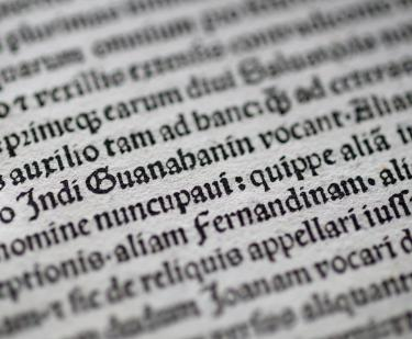 Detail of a printed page shows text in Latin.