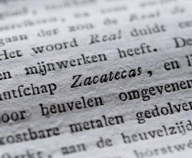 "Detail of a printed book shows text in Dutch, with the Mexican state ""Zacatecas"" written in italics."
