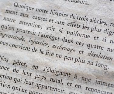 Detail of a printed book shows text in French.