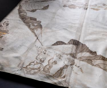 Detail of a manuscript map shows coastal profiles and women or mermaids holding the flags of Ireland, Scotland, and England.