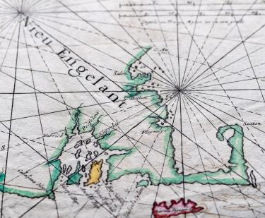 "Detail of a colored engraved map shows latitude and longitude lines and label in English over New England written as ""Nieu Engelant."""